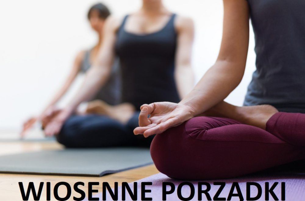 Women practicing yoga together and sitting in the lotus pose: mindfulness meditation, spirituality and healthy lifestyle concept